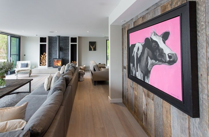 Contempary sleek interiors with provocative artwork from amongst others, Banksy & Damien Hurst