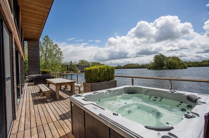 A hot tub is available to relax in, on the outdoor terrace