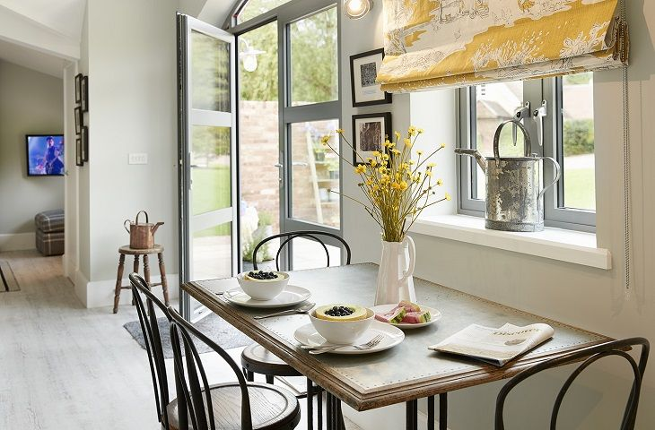 Ground floor: Open plan dining room with french doors to outside patio