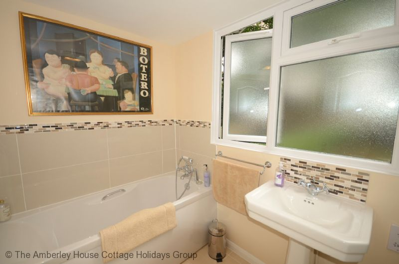 Large Image - Family bathroom with full bath and shower cubicle