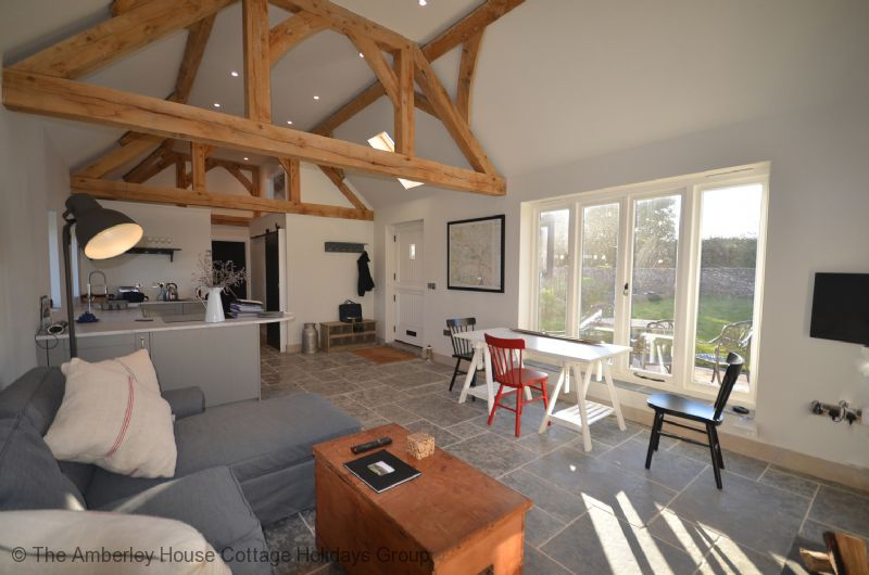 Large Image - The beautifully light living area overlooking the front terrace