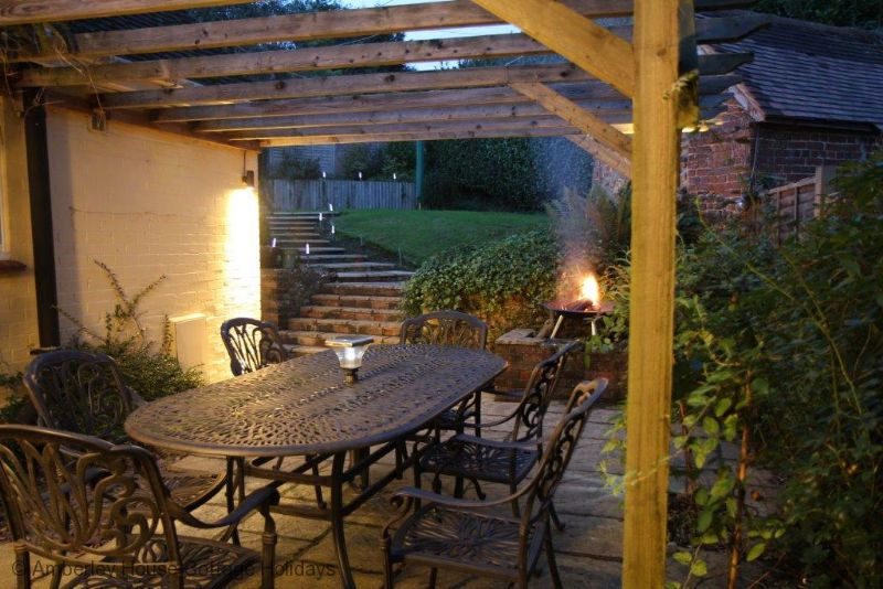 Large Image - The terrace in the evening with the fire pit lit
