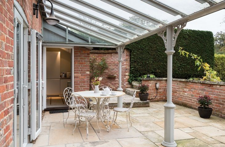 French doors open out on to the outdoor patio and garden which is perfect for al-fresco dining