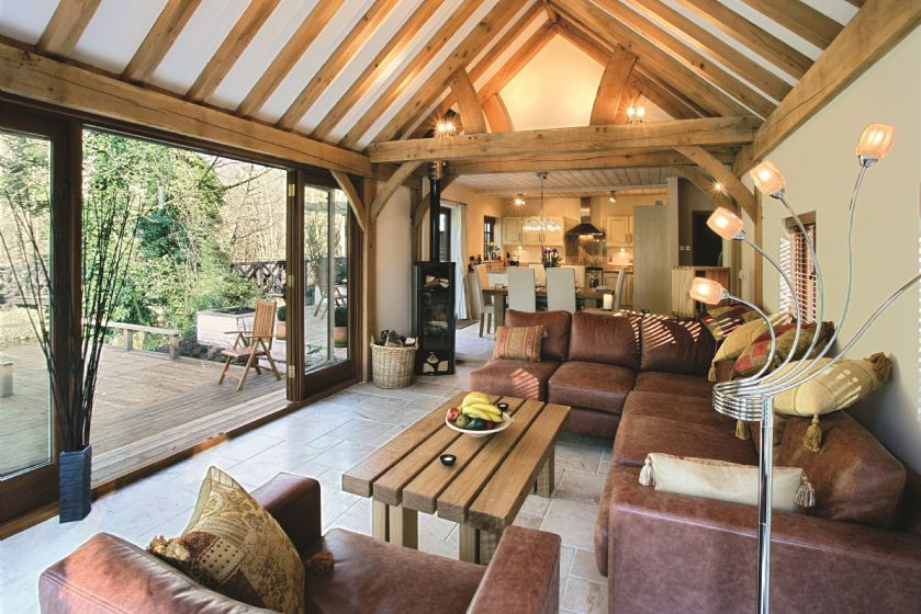 Ground floor: Open-plan living space with wood burning stove, adjoining dining room and kitchen