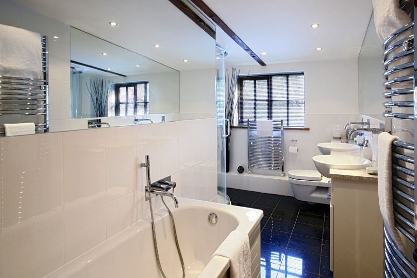 First floor:  Family bathroom with bath, twin basins and separate shower
