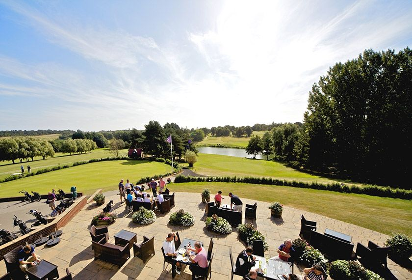 Open air dining area with a view of the golf course
