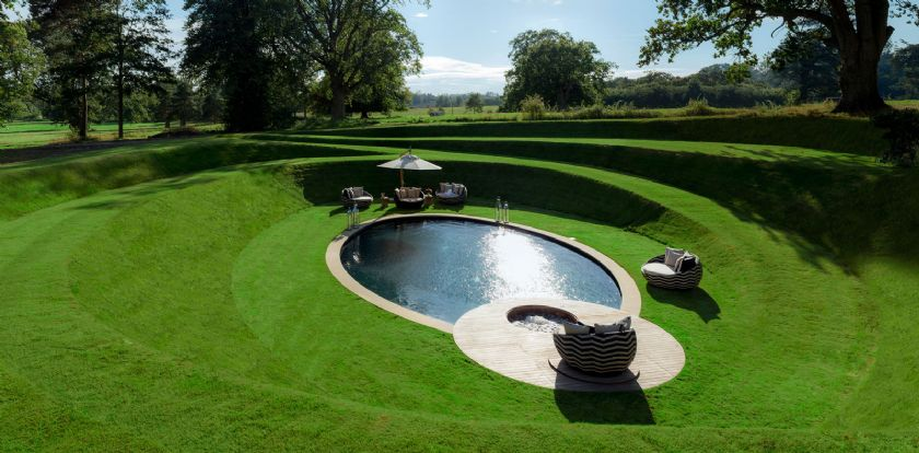 Outdoor swimming  pool and hot tub with deck beds