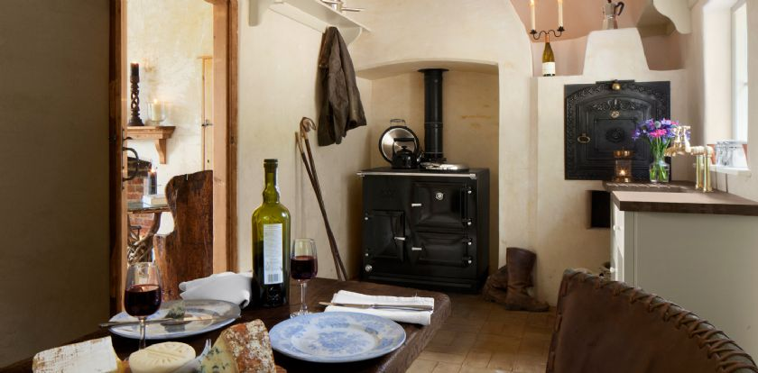 Ground floor: Kitchen with an original bread oven and antique table seating four