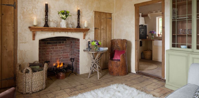 Ground floor: Sitting room with open hearth fire