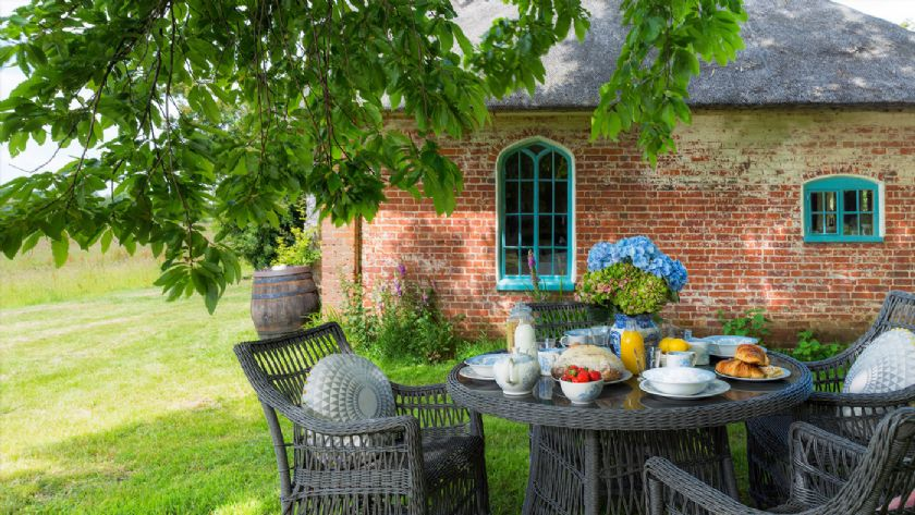 Hex Cottage with outdoor table and chairs