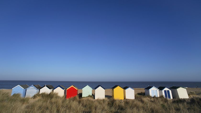 Beach huts along the beach front at Southwold