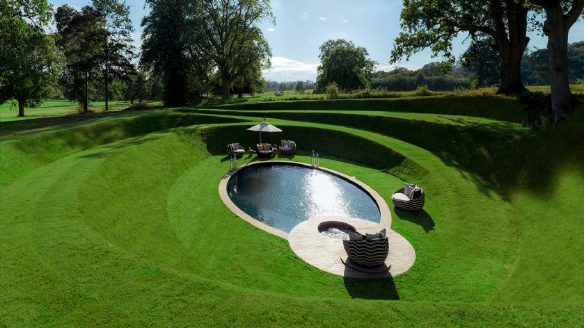 Outdoor swimming  pool and hot tube with deck beds