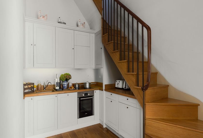 Kitchen with stair case to the upper foor