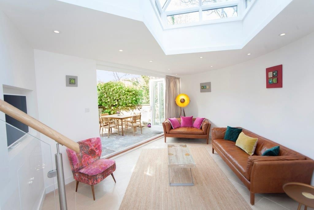 Sun filled living room leading to garden