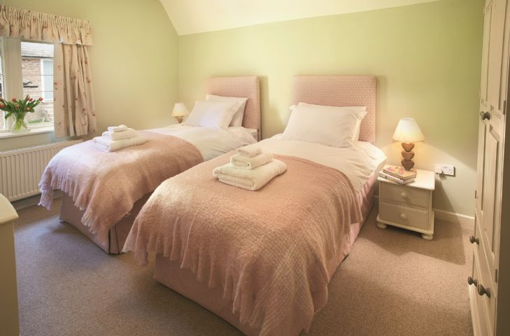 First floor:  Double bedroom with 6' zip and link bed (can convert to singles on request)