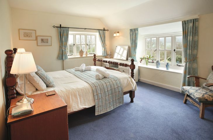 First floor: Master bedroom with 5' double bed, en-suite bathroom and double aspect windows