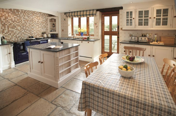 Ground floor: Kitchen with Aga, breakfast table and stable doors overlooking the private garden