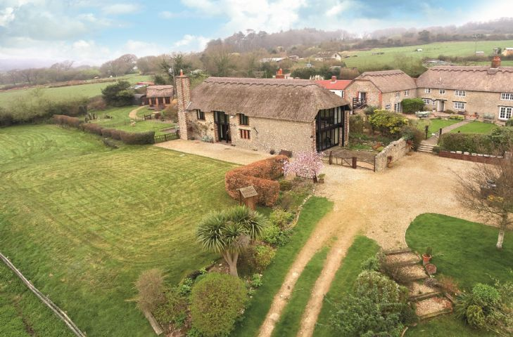 Champernhayes Barn is an impressive 15th Century barn that has been restored to original thatch and overlooks a beautiful valley with views of the Charmouth Sea