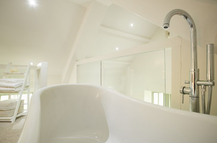 Freestanding roll top bath in the master bedroom