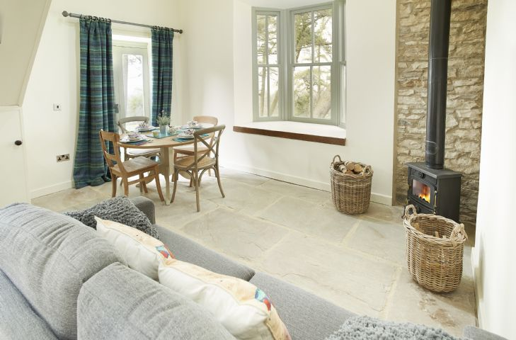 Ground floor sitting room and dining area with wood burning stove