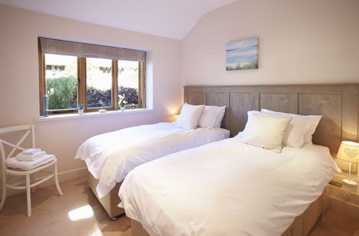 Ground floor: Double bedroom with 6' zip and link bed (can convert to two 3' singles upon request) overlooking the garden
