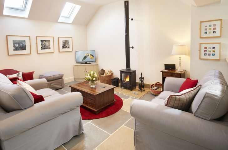 Ground floor sitting room with wood burning stove