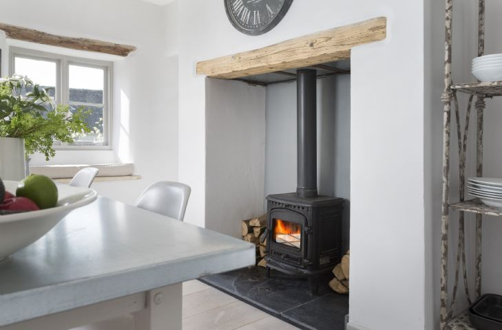 Ground floor: Kitchen/dining room with inglenook fireplace and wood burning stove