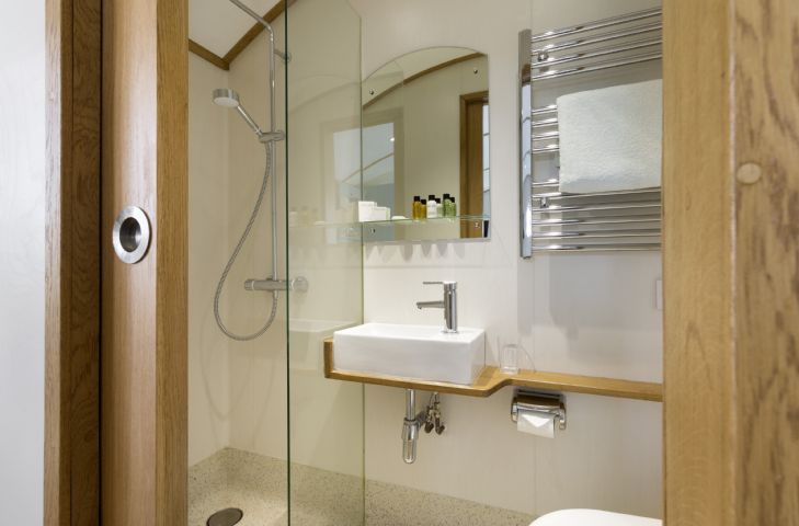 En-suite shower room with walk in shower