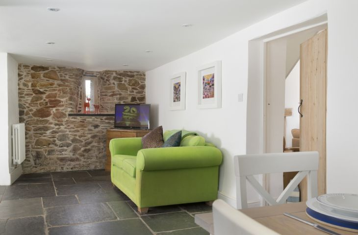 Ground Floor: Dining area leading to pretty rear patio terrace