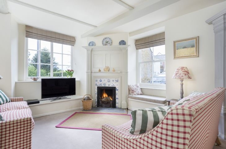 Ground floor: Sitting room with double aspect windows and open fireplace