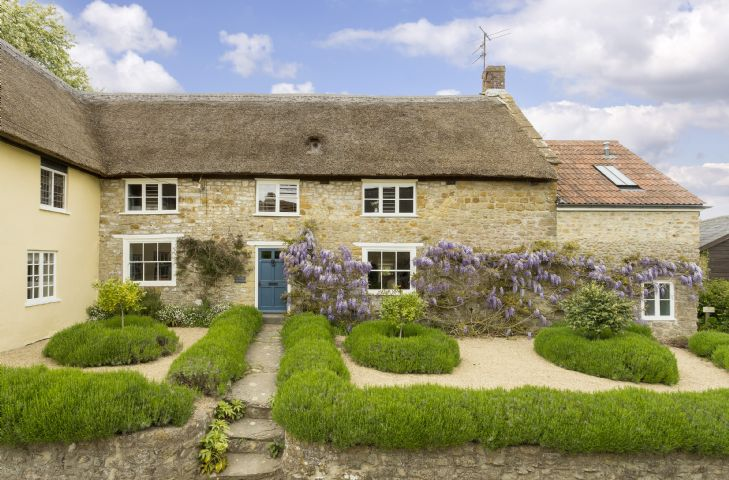 Myrtle Cottage is an attractive Grade II listed stone and thatched cottage in the centre of the pretty village of Netherbury