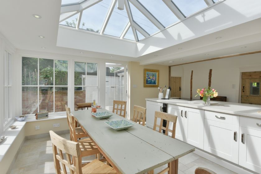Spacious open plan kitchen and dining room filled with light