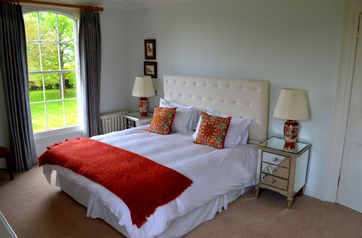 First floor:  The White bedroom with 6' Superking bed and en-suite shower room.