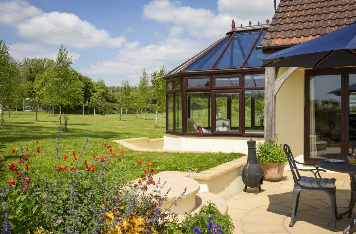 Guests have access to a two acre field with a tree planted area and open field, adjacent to a large unfenced garden pond