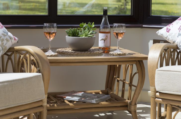Enjoy an evening glass of wine in the light and bright conservatory