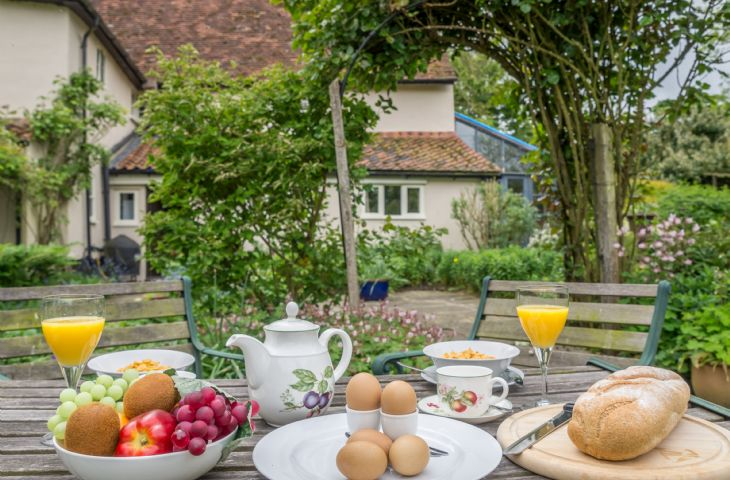 Enjoy breakfast outside in the charming private garden