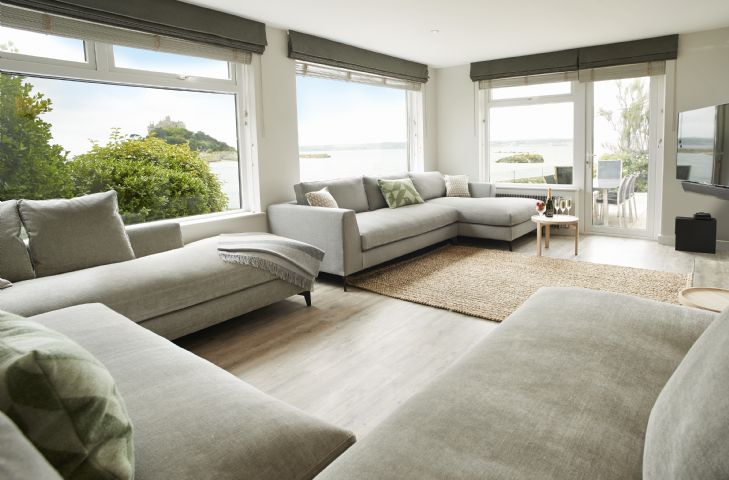 Sitting room is renovated to a high standard and all furniture is styled in a classic colour scheme soft furnishings are in warm coastal accent tones all selected by an Interior Designer with spectacular views opening onto outdoor dining area