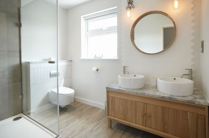 En-suite bathroom to master bedroom with twin basins all bathrooms are renovated to a high standard stylish and practical with a coastal feel