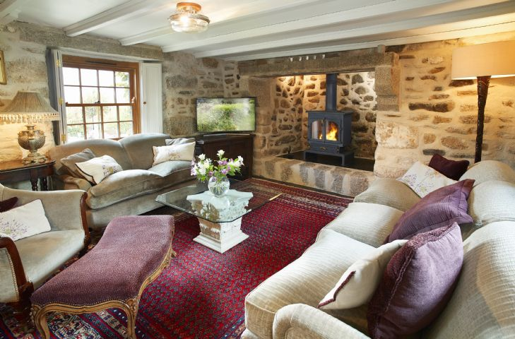 Ground floor: Large characterful sitting room with wood burning stove