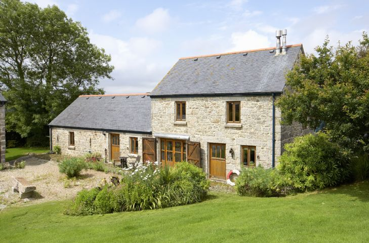 The Barn lies a quarter of a mile down its own lane with stunning views across rolling farmland adjacent to Cornwall's Trevarno Estate and Gardens