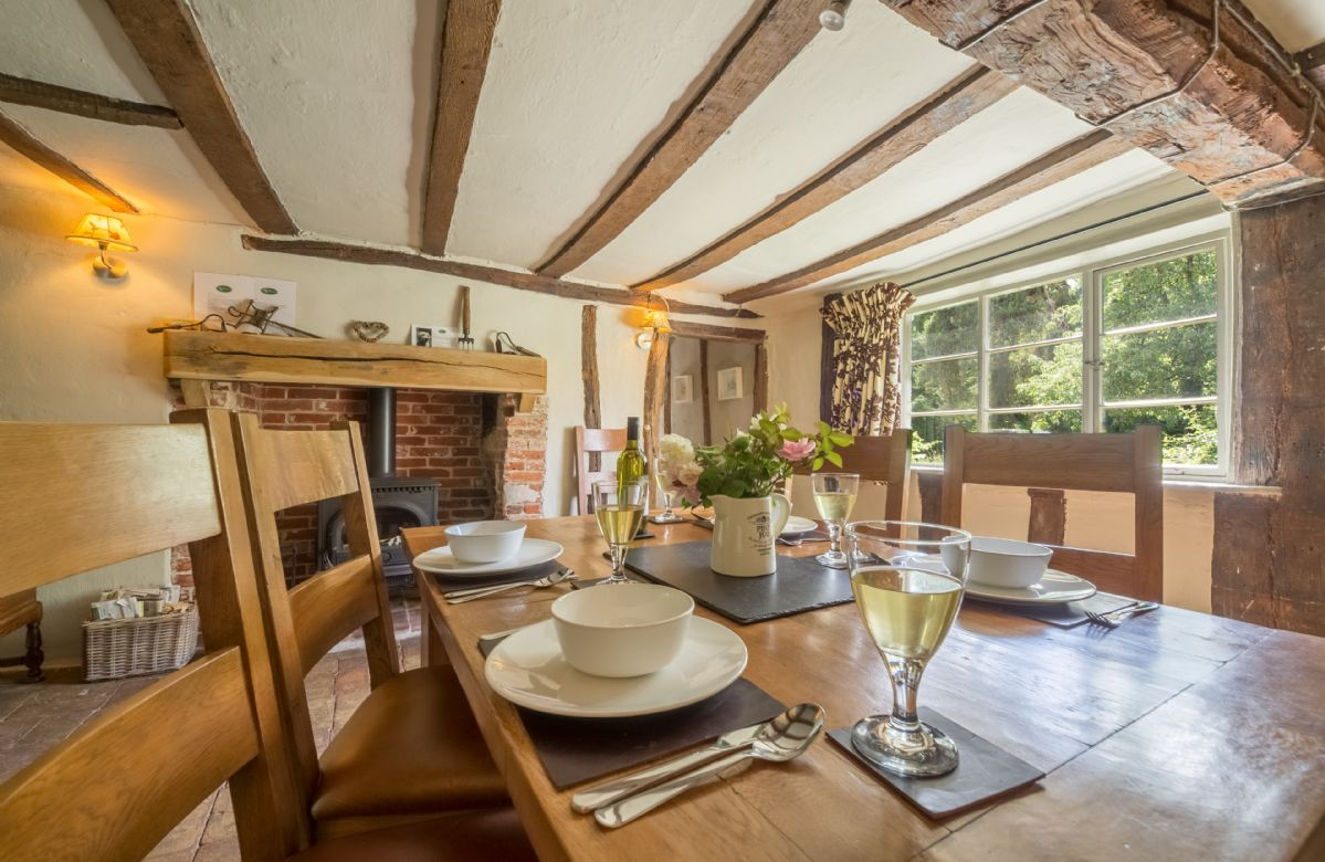 Ground floor:  Dining room with an inglenook and wood burning stove
