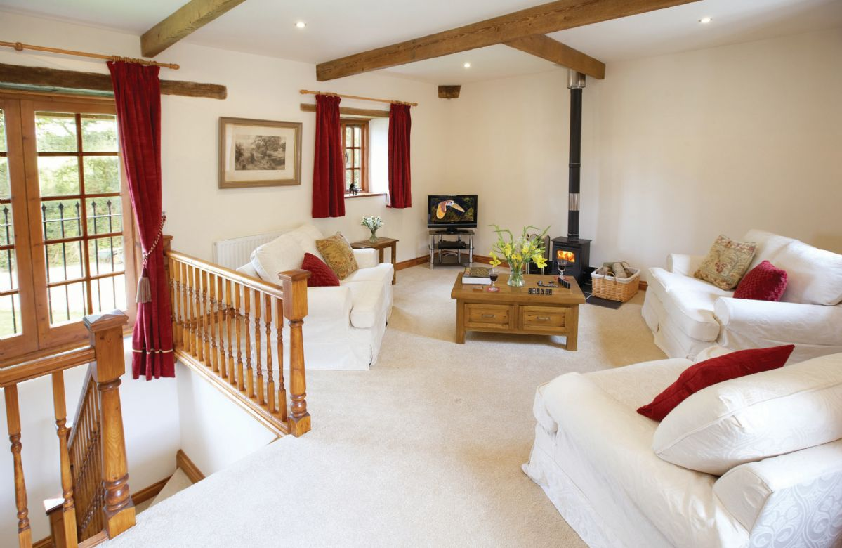 First floor: Spacious sitting room with wood burning stove