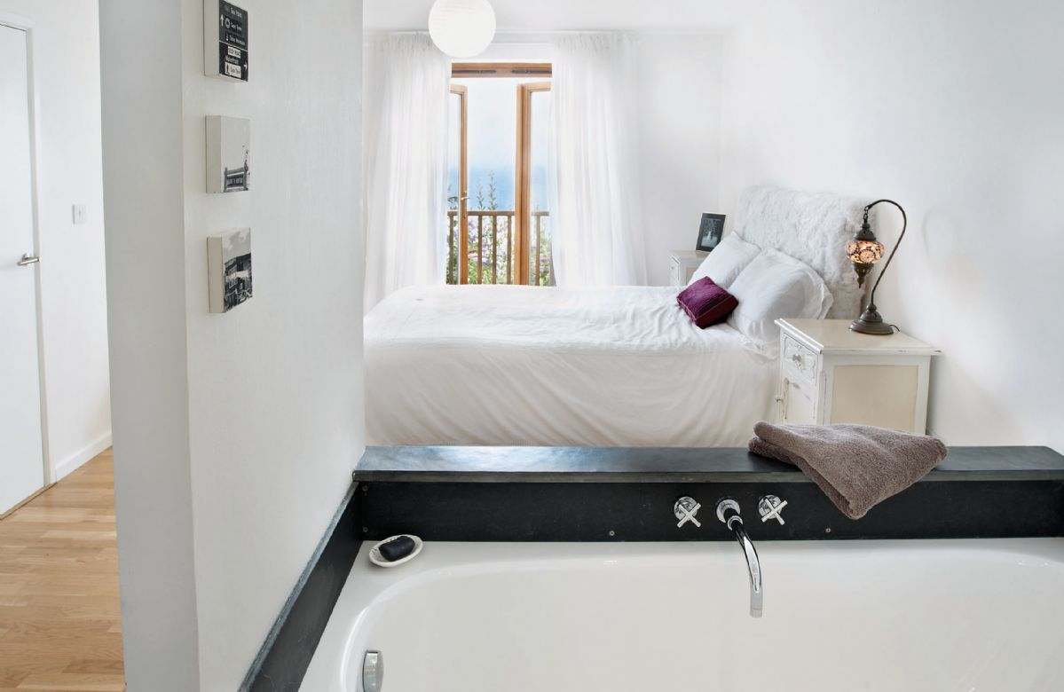 Lower ground: Master bedroom with romantic views of the bay and its own balcony with 5' bed and en suite bathroom with bath and separate double shower
