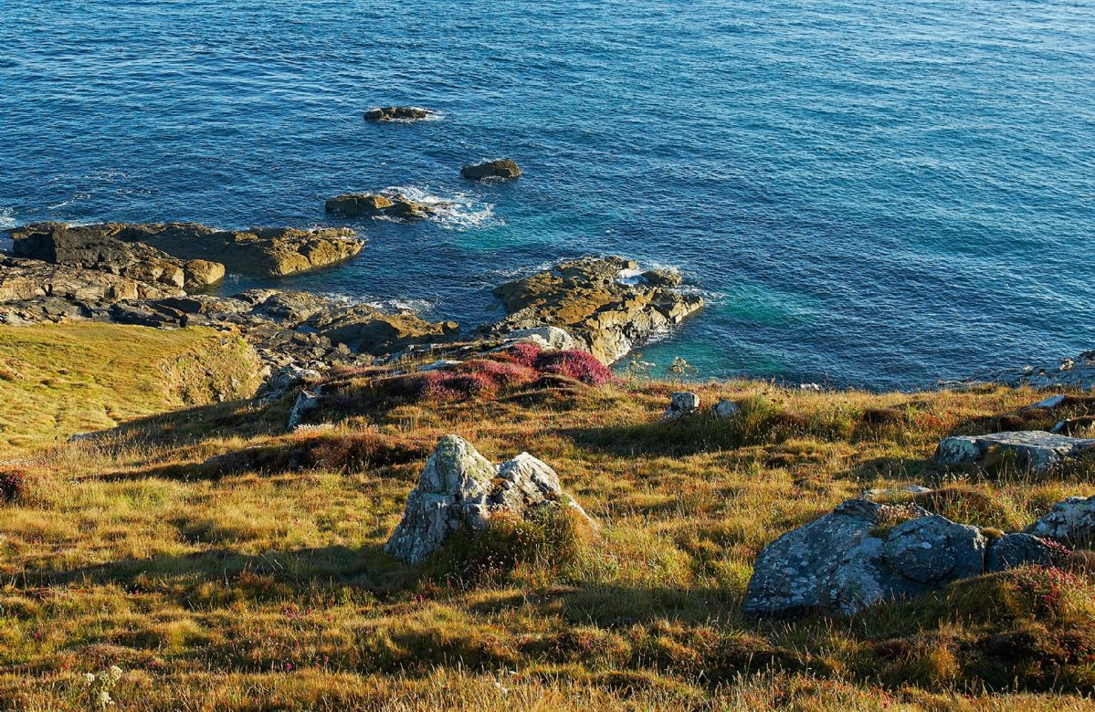 The South West Coast path passes round the headland
