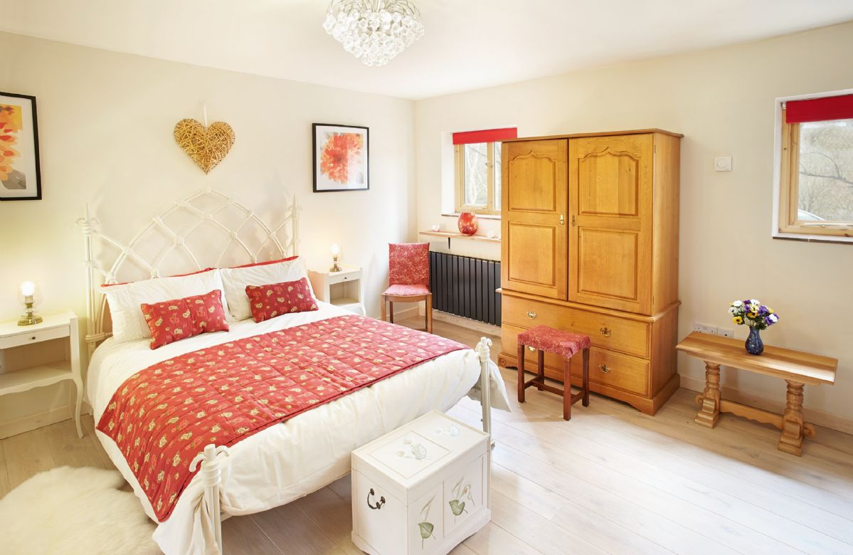 Ground floor:  Double bedroom with 5' cast iron Gothic bed and copper bath
