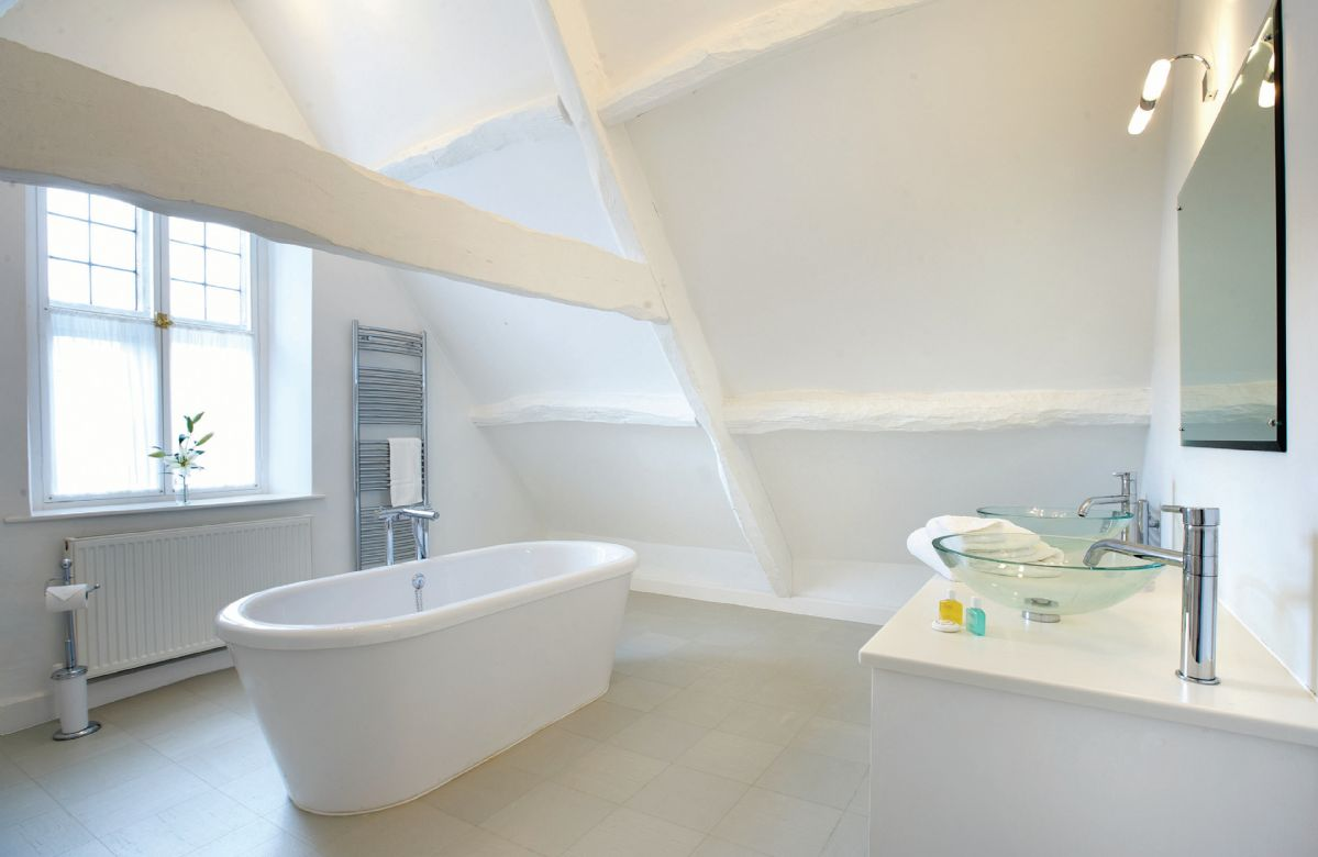 Attic bathroom with large roll-top bath