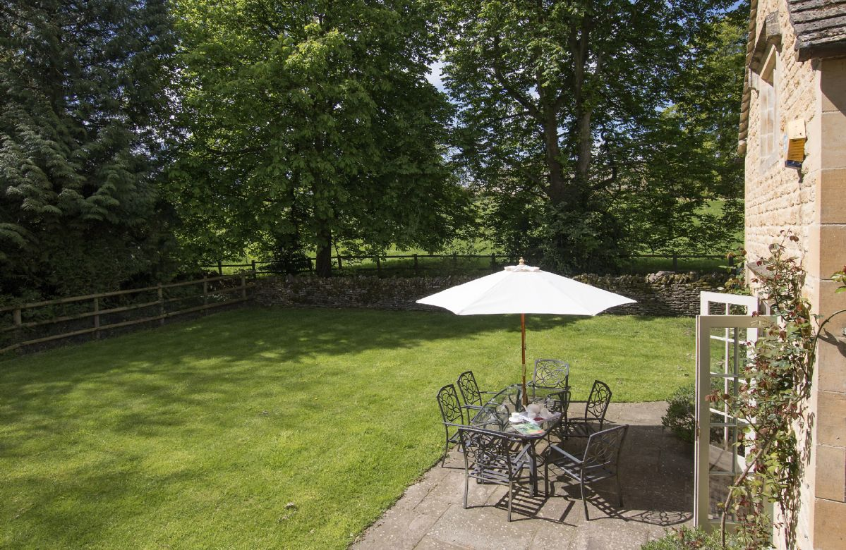 Large lawned, south facing garden overlooking shallow, but fast flowing river, and backing onto private woodland - completely fenced off and child safe. Parents must be aware that although the garden is fenced a watchful eye must be kept on the children