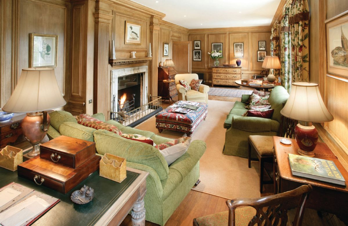 Ground floor: Oak-panelled drawing room with an open fire and external door giving onto the rose garden