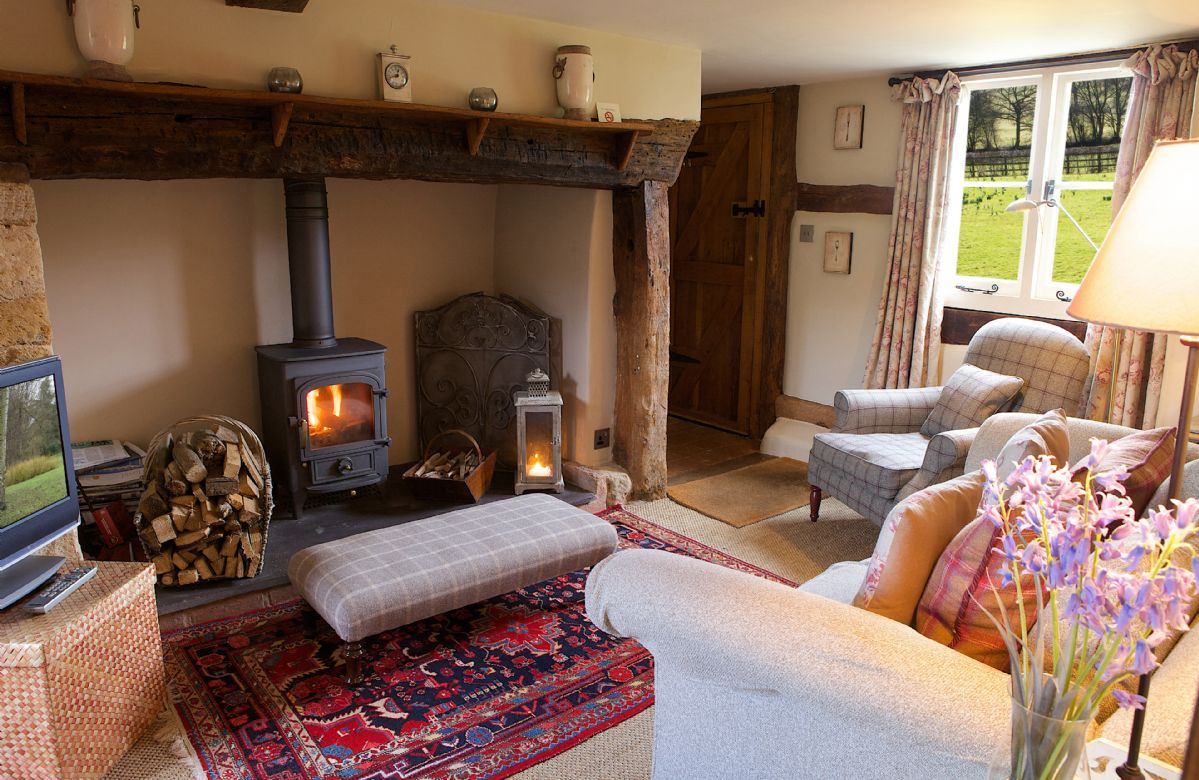 Field Cottage: Ground floor, cosy sitting room with wood burning stove