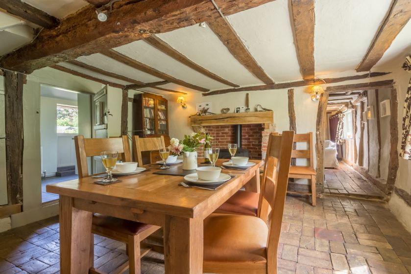 Ground floor: Dining table seating four with wood burning stove